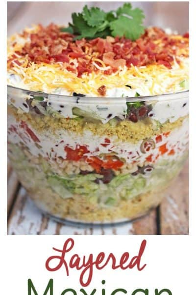 This Layered Mexican Cornbread Salad Recipe is HUGE hit at potlucks. There are never leftovers!