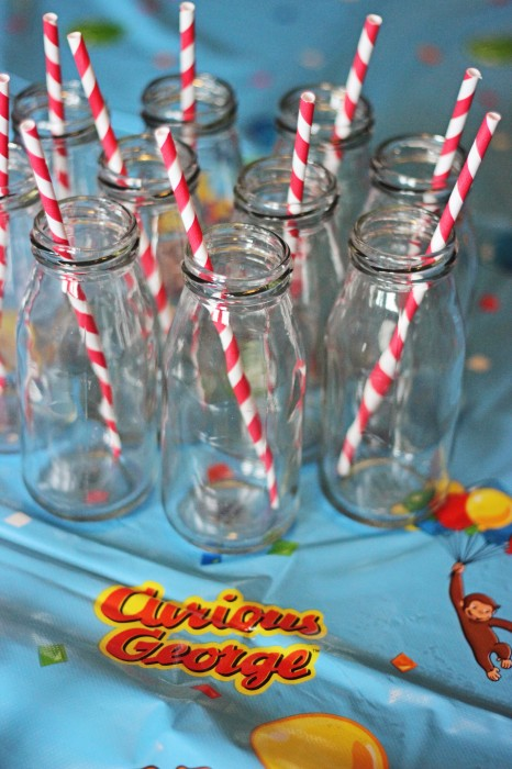 Curious George Birthday Party Milk Bottles with Red Paper Straws