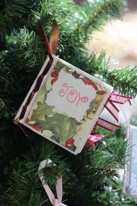 Make your own Photo Album Christmas Ornaments out of paper bags, scrapbook paper and some ribbon. Easy gifts or group crafting activity!