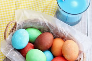 Learn How to Dye Easter Eggs with Kool Aid and keep this year's Easter eggs decorating simple! You can go for a speckled look or a smooth finish depending on your preference.
