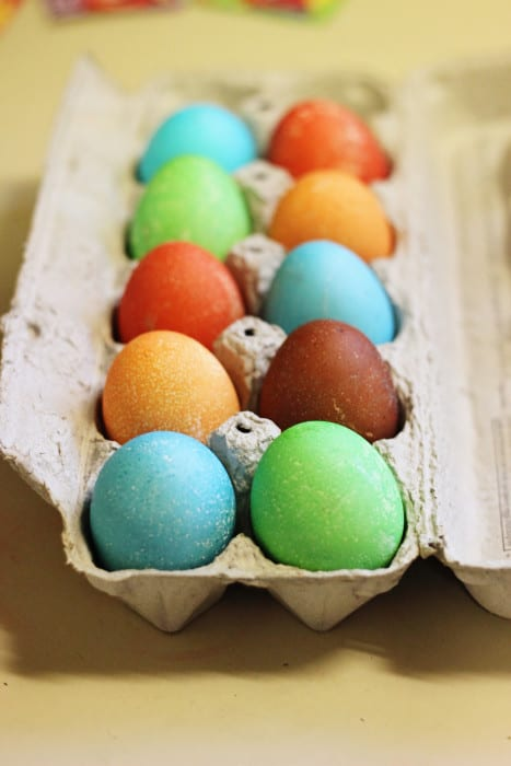 Learn How to make speckled Easter eggs with Kool Aid and keep this year's Easter eggs decorating simple! You can actually go for a speckled look or a smooth finish depending on your preference.