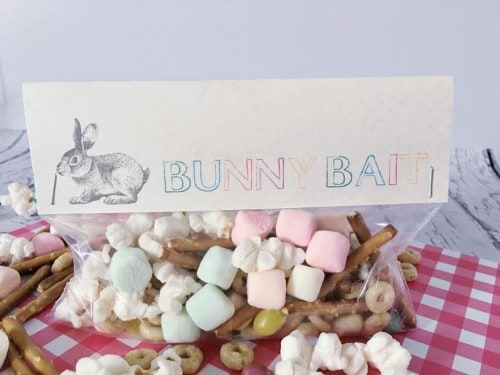 This Easter recipe doubles as an Easter craft thanks to the free printables. Use the bag toppers to package your bunny bait recipe for fun easy Easter treats or the square labels to decorate a bucket of bunny bait for Easter dessert at the kid table!