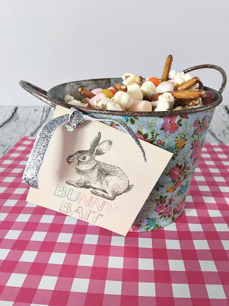This Easter recipe doubles as an Easter craft thanks to the free printables. Use the bag toppers to package your bunny bait recipe to share with friends or the square labels to decorate a bucket of bunny bait for Easter dessert at the kid table!