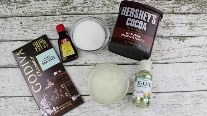 Use this Dark Chocolate Coconut Lip Scrub recipe to keep lips soft and smooth. It's the perfect lip scrub for dry lips! Homemade lip scrub never tasted so good.