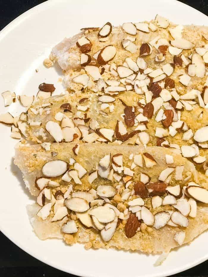 Tilapia fillets topped with almonds