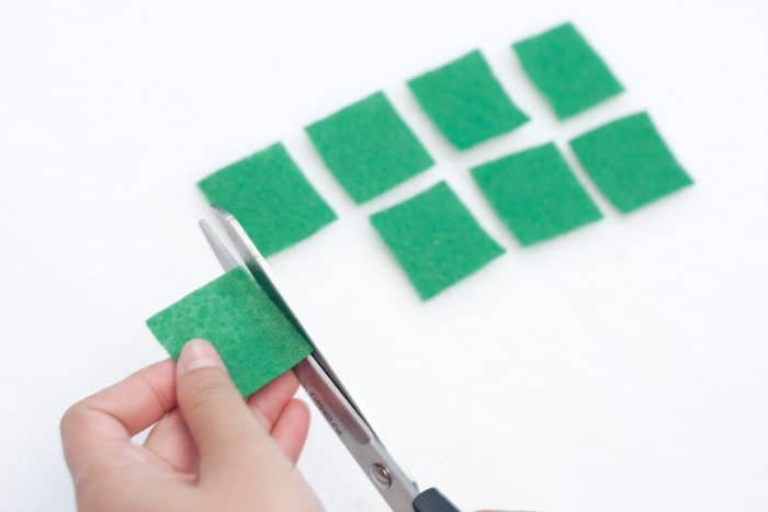 shamrock hair clips cutting squares from felt