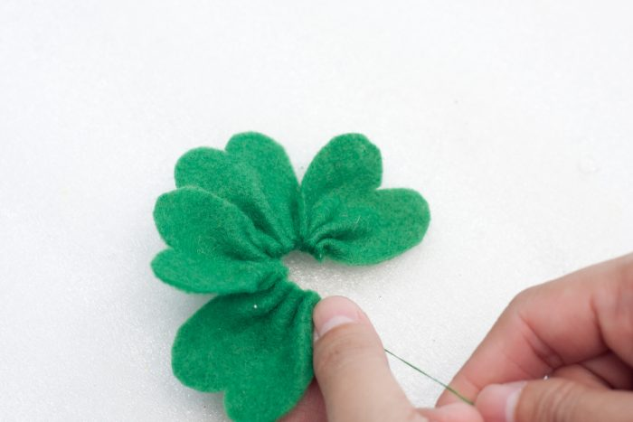 tightening running stitch to being shamrock leaves together