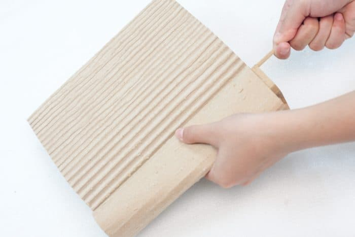 removing cardboard layers with a skewer