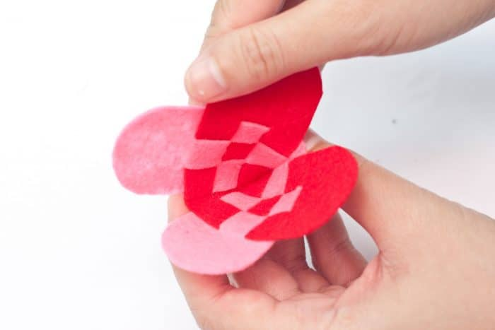 weaving a heart from felt to make a DIY bag charm craft