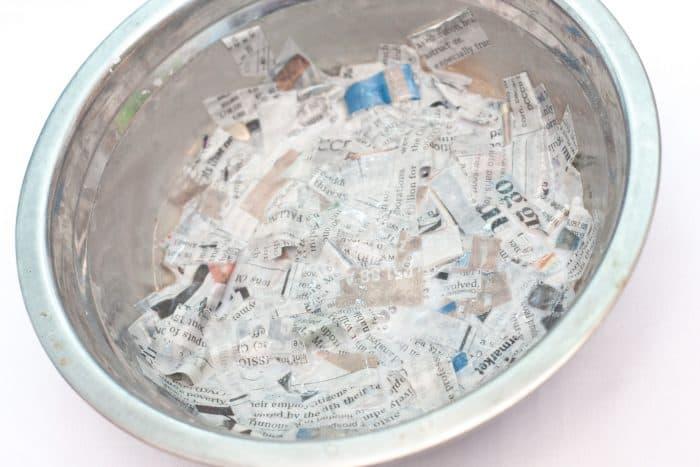 wet newspaper strips in paper mache