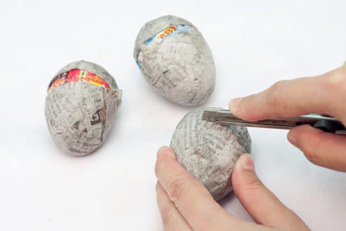 cutting dry paper mache eggs