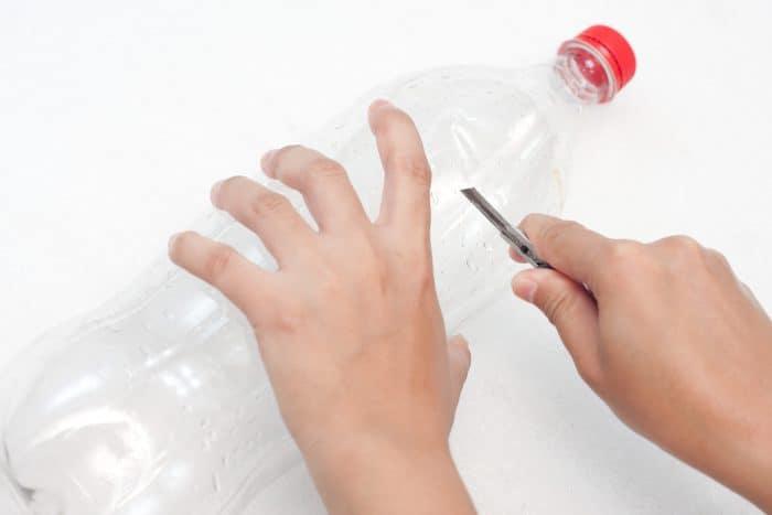 diy fly trap cutting a soda bottle