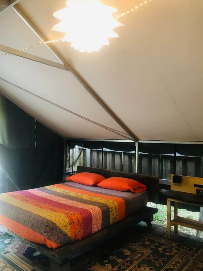 bed inside a glamping tent