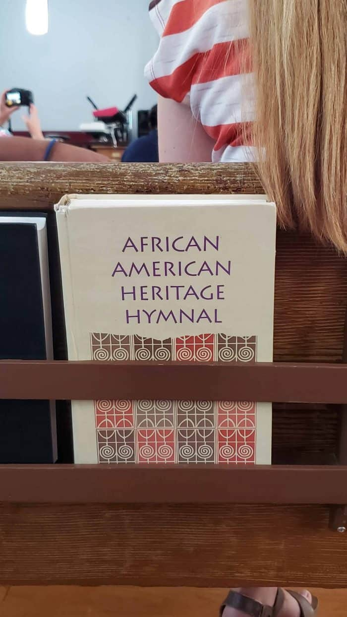 african american heritage hymnal resting in a pew back