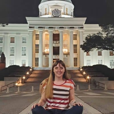 sitting on the street in front of the state capitol building in Montgomery Alabama