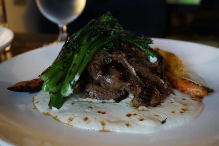 lamb on a bed of creme fraiche topped with broccolini