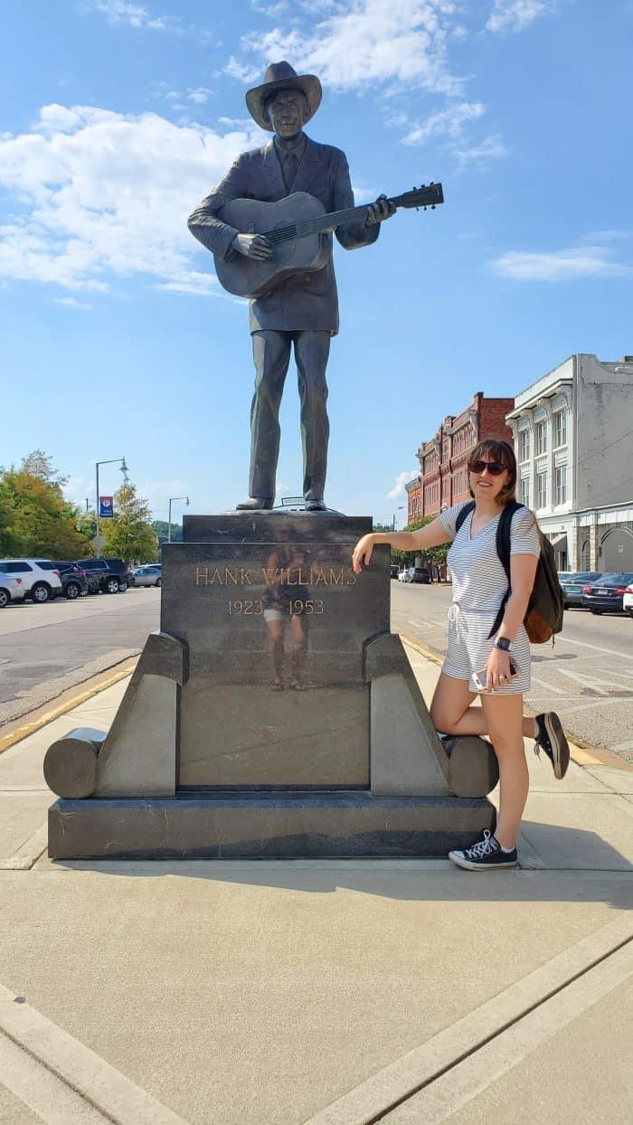 posing with the hank williams statue montgomery, alabama riverwalk