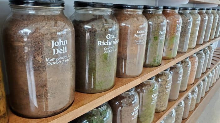 jars of dirt labeled with the name of the people lynched on the site where the dirt was collected