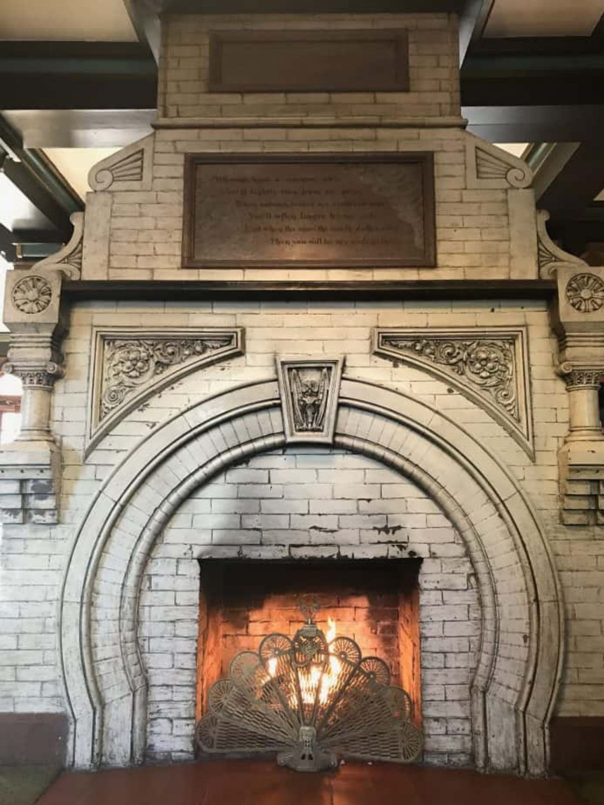 the antique original fireplace inside the lobby of the crescent hotel.