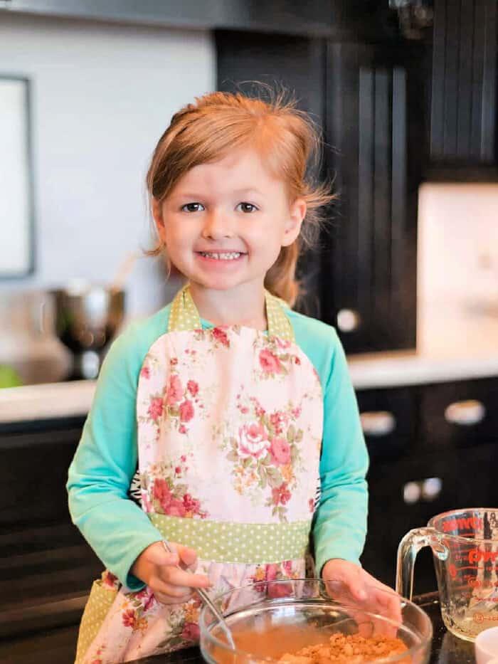 Child making honey bun cake