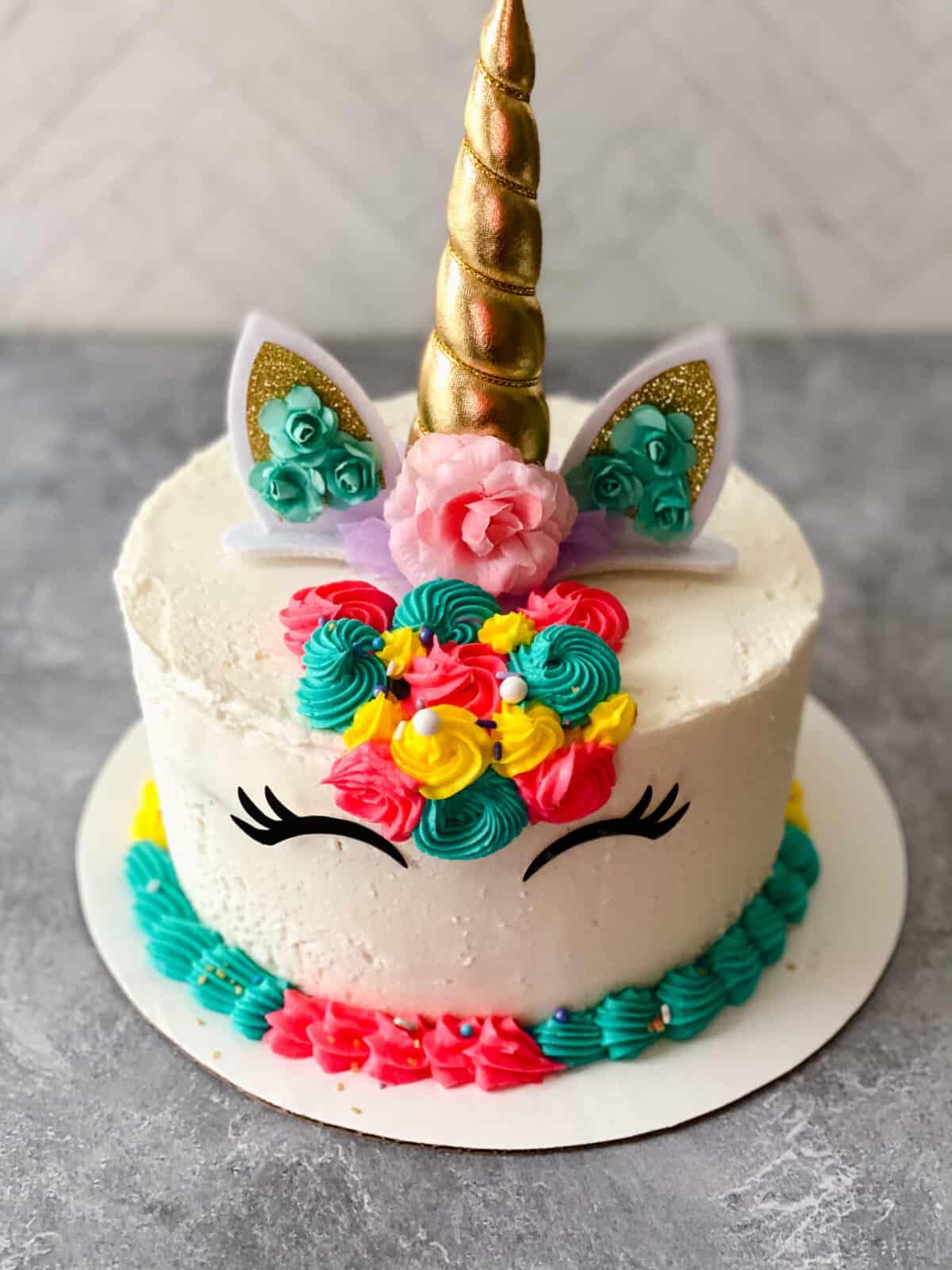 completed unicorn rainbow cake unsliced