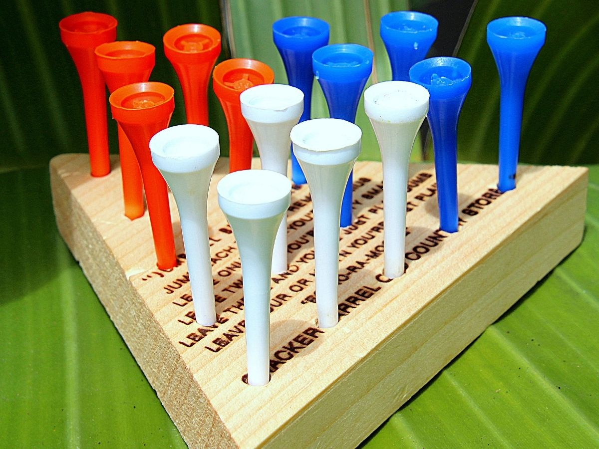 close up shot of the cracker barrel triangle peg game with a wooden base and red, white, and blue pegs.