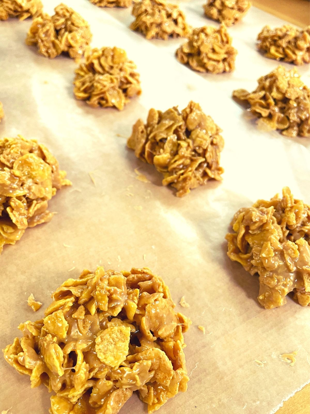close up of finished cornflake candy cooling on wax paper.