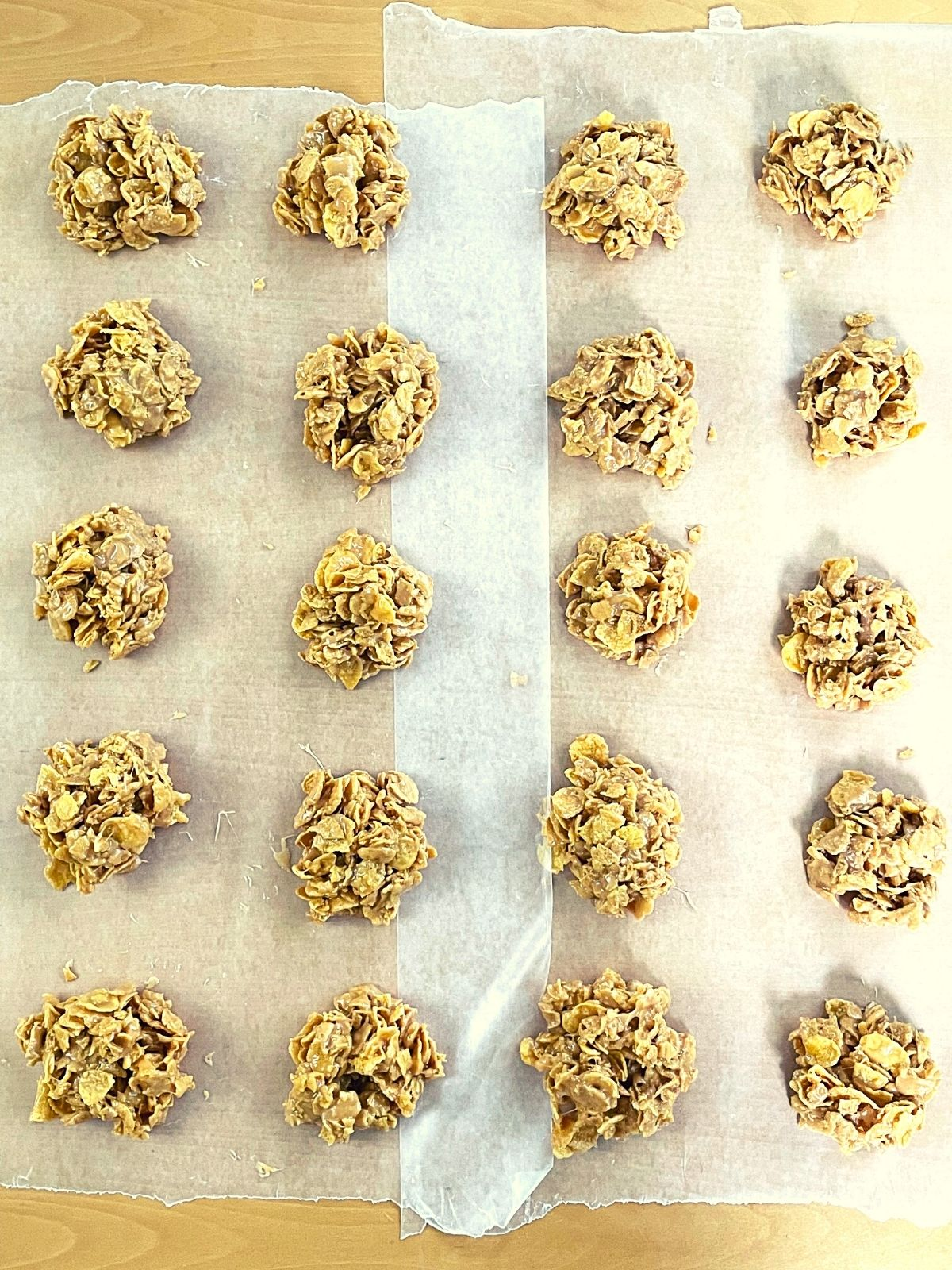 cornflake cookies cooling on wax paper.