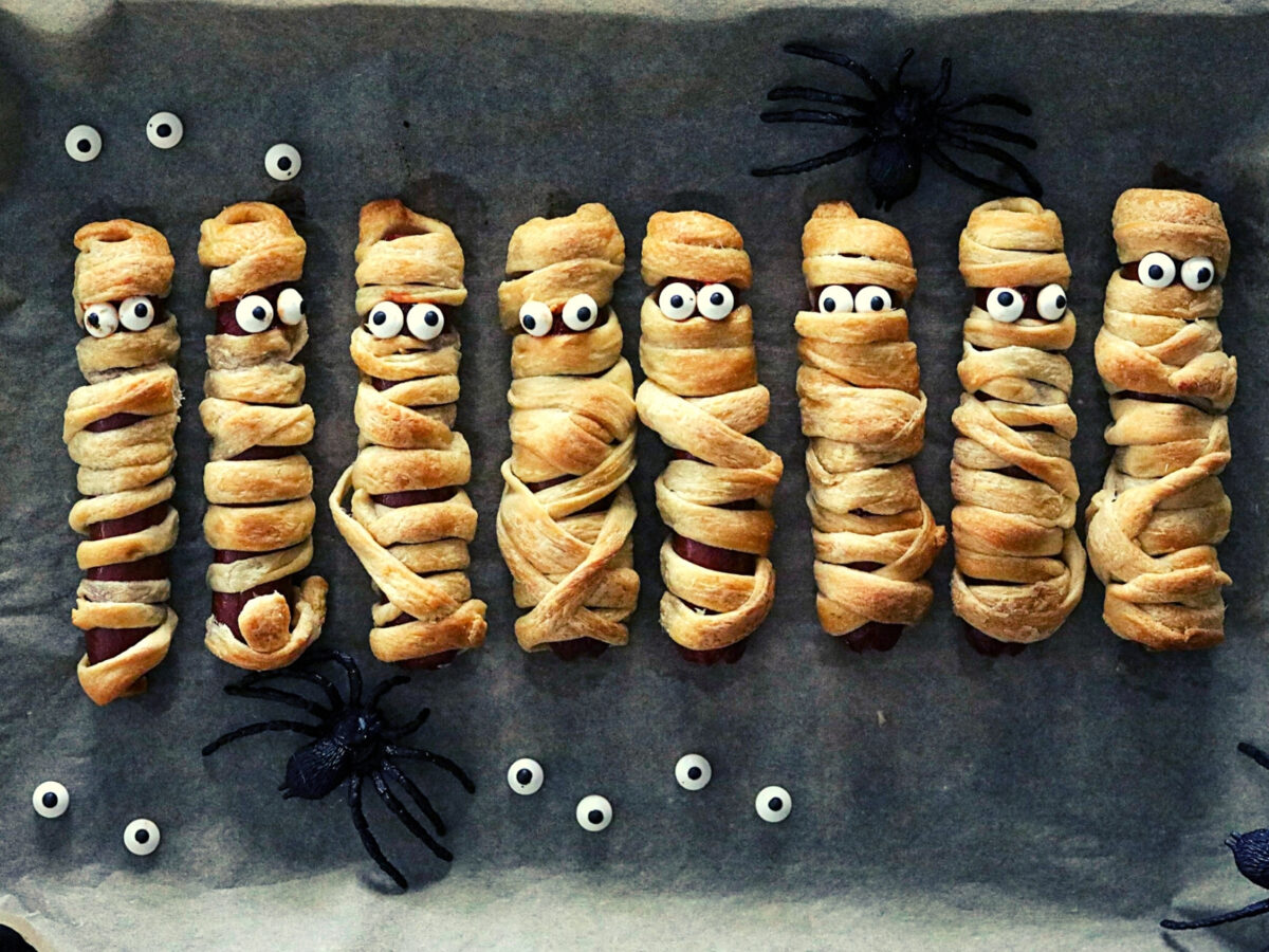 Mummy hot dogs cooked and decorated.
